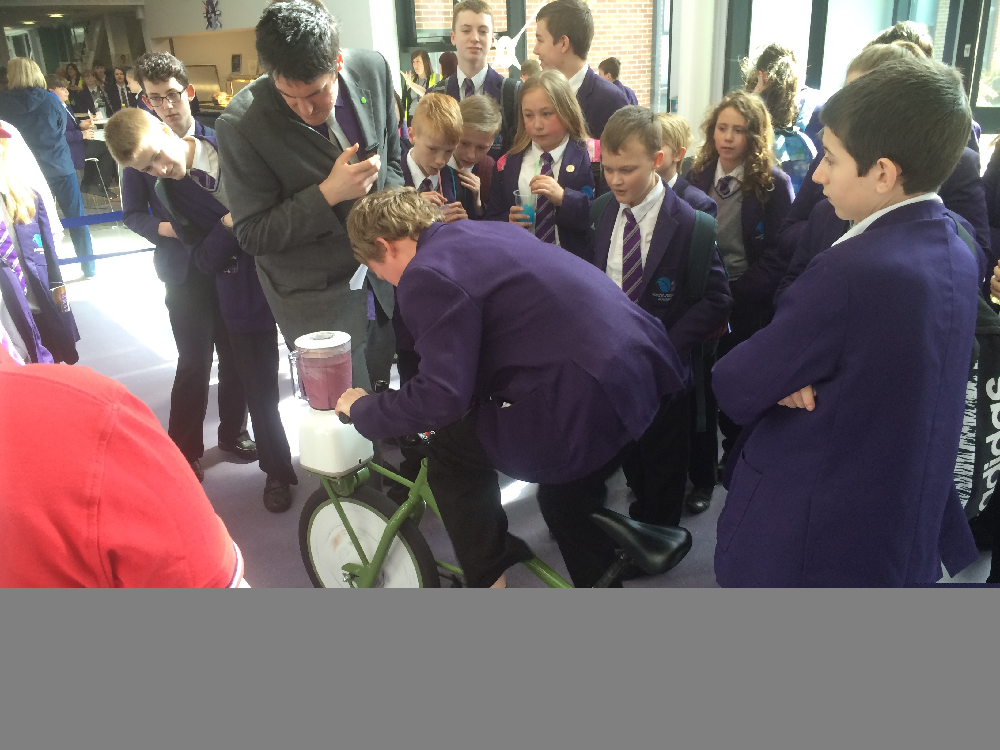 Competitive fun on a smoothie-maker bike during Grand Prix Day