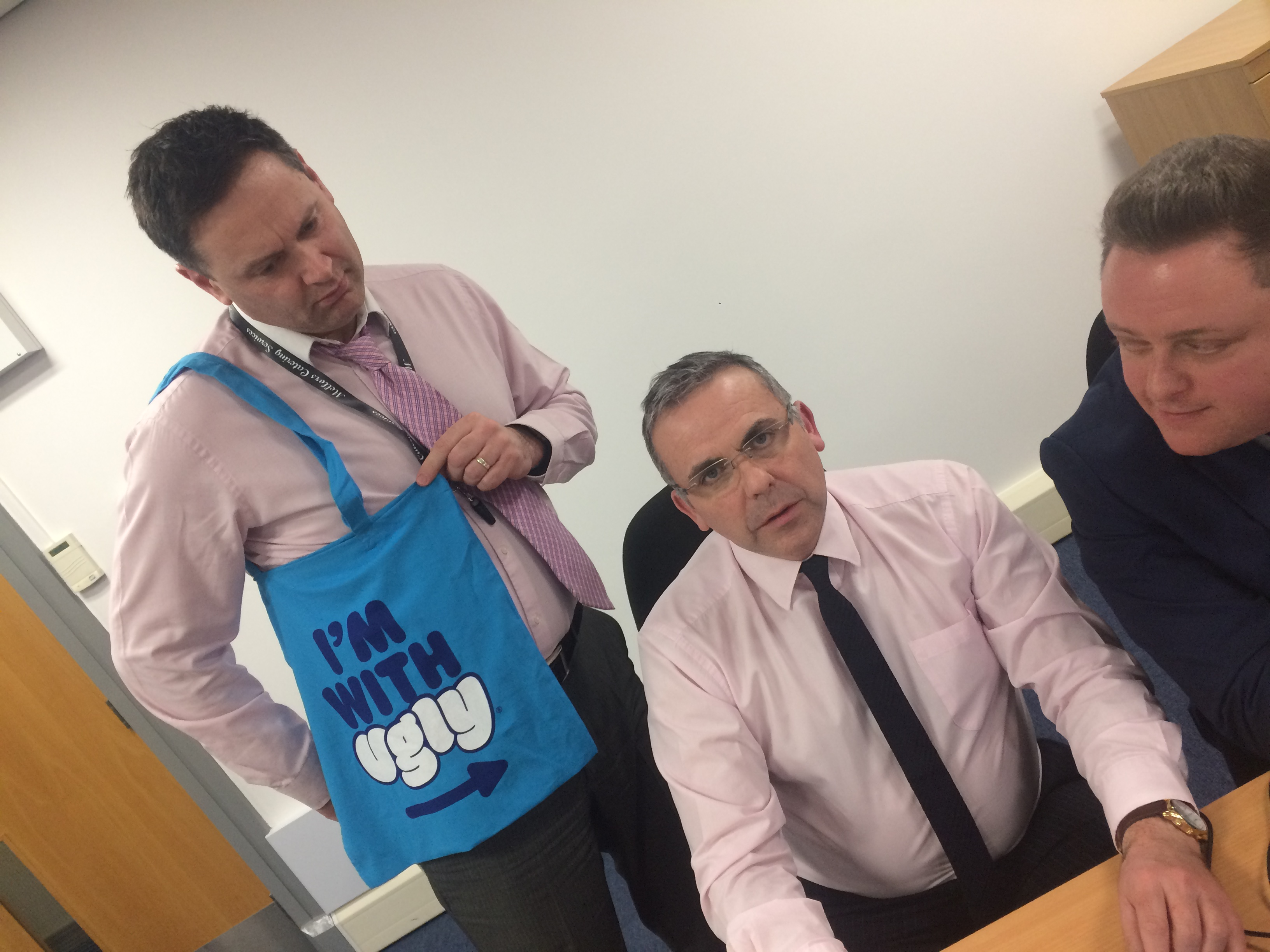 Tony Trainor, Mark Lyons and Scott Hickman pondering over some head office innovations